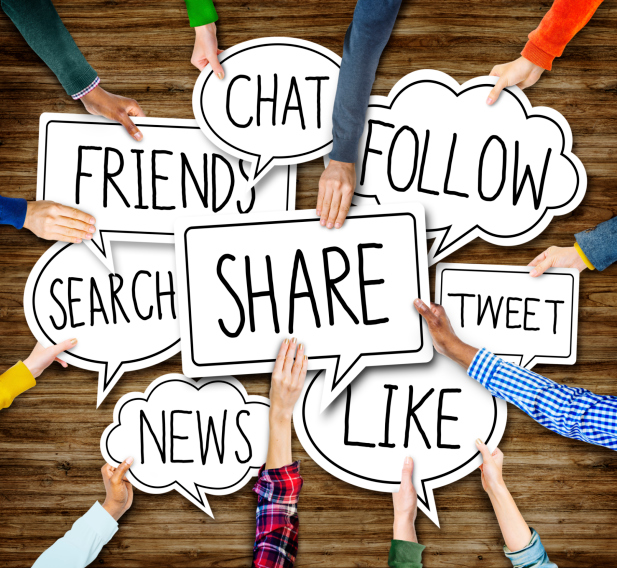 Group of Hands Holding Facebook Marketing Keywords